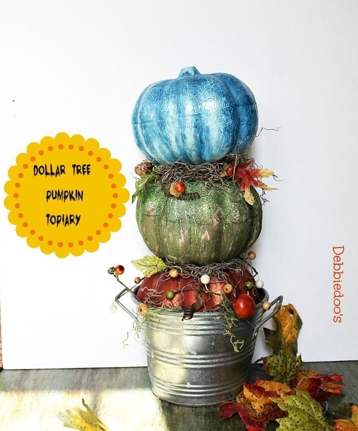 How to make a dollar tree pumpkin topiary ~ love this craft idea...do not love the color choices.