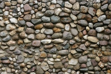 Trying to build a similar stone wall down my driveway as a border with stone from our property.