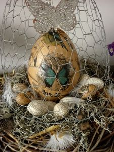 Decoupage Easter Eggs in wire cage  This is so different! I like the eggs in the wire cage nest.