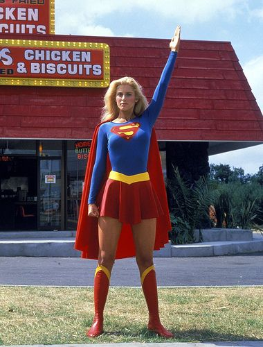 Supergirl taking an moment from fighting crime to pose for a photo in front of her favorite fast-food chicken restaurant