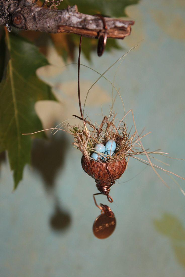 "Fairy garden miniature acorn bird's nest with tiny brass ""believe"" charm. $6.99, via Etsy."