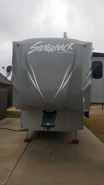 2013 Used Forest River CEDAR CREEK SILVERBACK 35QB4 Fifth Wheel in Arkansas AR.Recreational Vehicle, rv, 2013 Forest River Cedar Creek Silverback 35QB4, 2013 Cedar Creek Silverback bunkhouse. 4 slides, 2 bathrooms, huge bunk room in back that is perfect for kids. Fireplace in living room. Includes master bedroom ( upgraded mattress and living room t.v.'s. washer/dryer combo and 3 a/c units.Directv automatic sat on roof. GREAT condition. If you have seen what these sell for new, you will love…