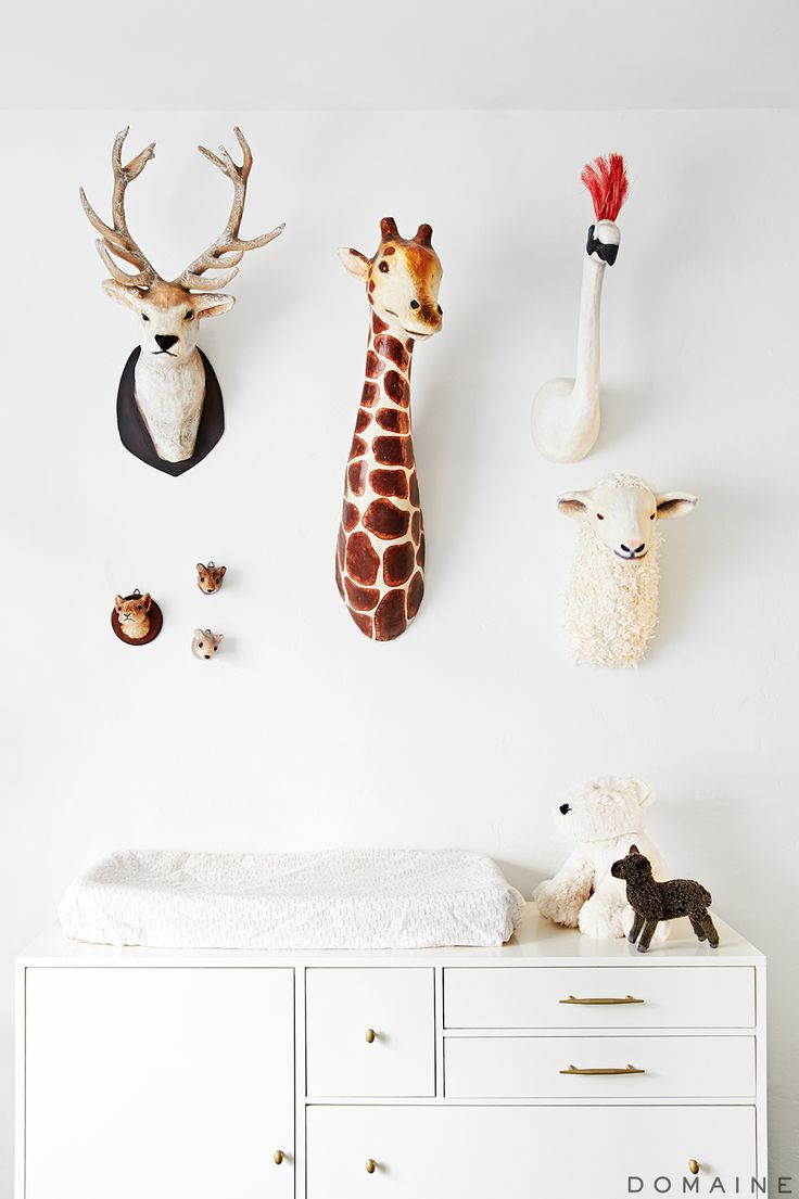 nursery with faux animal heads mounted on wall: x plush wall