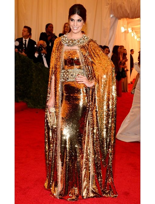 Bianca Brandolini D'Adda  Dolce & Gabbana custom-made gold sequin gown with multi-color belt and matching cape