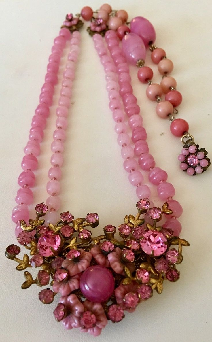 The necklace consists of 2 strands of pink art glass beads coming to a center cluster of pink art glass flowers and pink chaton stones surrounded by brass leaves. The strands have 2 middle brass medallions with art glass flowers attached flowing down to a decorated flower shepherds hook closure. | eBay!