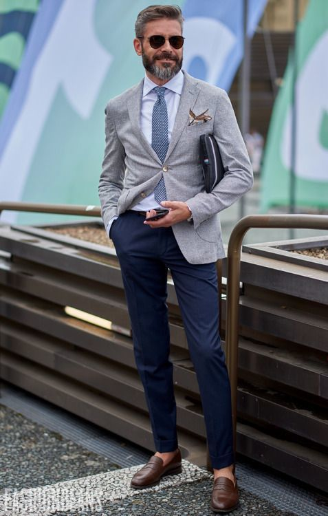 Pairing a grey coat with navy blue chinos is an on-point option for a day in the office. Round off this look with brown leather loafers. Shop this look on Lookastic: https://lookastic.com/men/looks/blazer-dress-shirt-chinos/20921 — Light Blue Dress Shirt — Beige Print Pocket Square — Blue Print Tie — Grey Blazer — Navy Chinos — Brown Leather Loafers