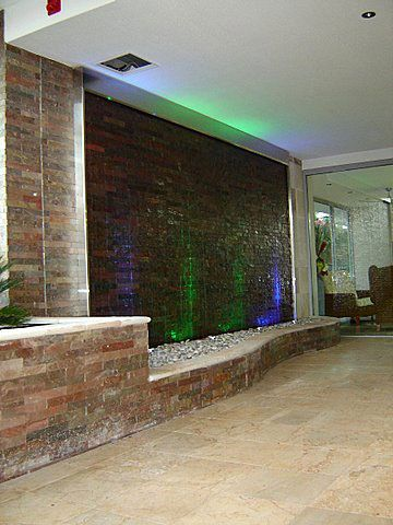 Stacked Stone Water Wall 3 - Redcliffe Apartments - Our clients requested a big and bold Stacked Stone Water Wall to complement contemporary styled beach front apartments. Really makes a statement to the apartment entry for visitors and guests.   Size: 4.4mtrs W x 2.7 mtrs H