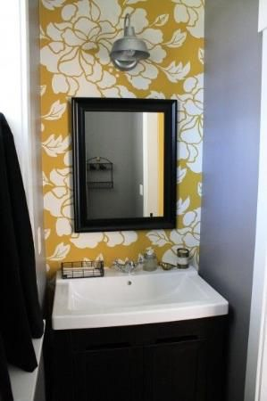 cool way to bring some fun into a small bathroom. one little wall with wallpaper :) not to mention gray and yellow! <3 by colorcrazy