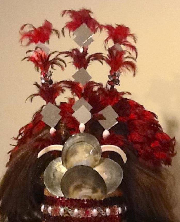 Samoan Taupou Headress. Originally worned by both male and female but now only the Chief's favored daughter would wear it during her performance. Legend has it that someone would be scalped to create this head dress but now it's just.... doll hair I think.