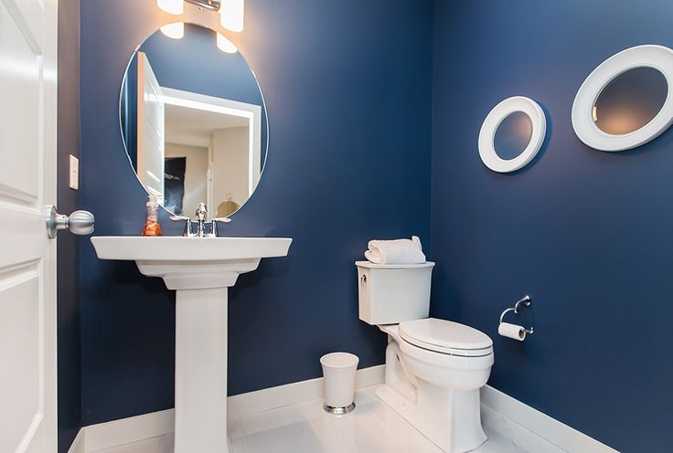 The rich blue in the half-bathroom really makes the space look fantastic!