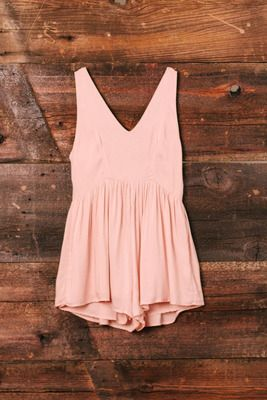 blush pink romper with flow shorts and v-neck cut