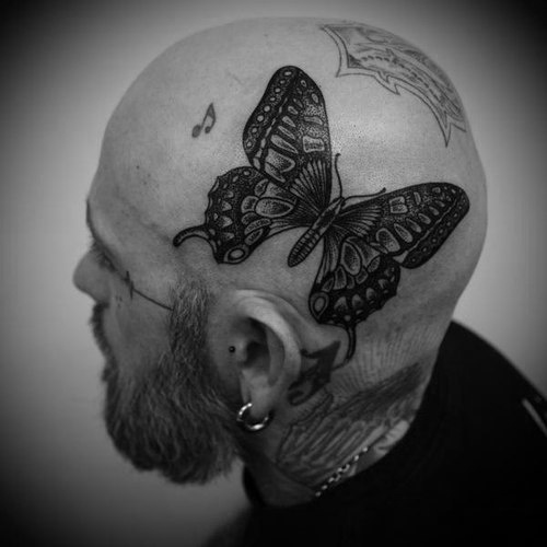 Guy with one big butterfly tattoo on his head. tattoo tattoos ink