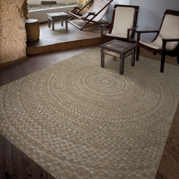 The Azure Swirl rug is a nautical inspired rug that brings durability as well as style to your floors. This rug includes gray, blue, beige and ivory in its design. The knotted circles look is innovative and unique for a machine woven indoor/outdoor rug.