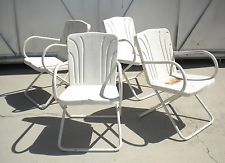 Appear to be a Paul Fleischer designed seat back on vintage metal chairs.  www.midcenturymetalchairs.com