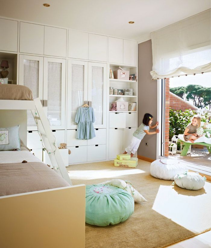 Built in along one wall. Beds along another. Still floor room for play.