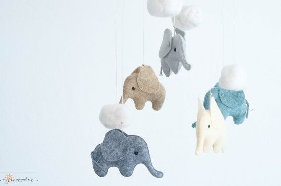 Baby Blue Yellow Beige Gray Elephant Mobile hanging is an adorable piece of art, perfect decoration for the Scandinavian, Woodland, Safari, Minimalistic Neutral Pastel styled Nursery; it'll surely become a perfect design item in your babys or family room. Its also a unique and cheerful Safari , Elephant Baby Shower Gift . ♡ You can choose any color according to your room style. For mobile on photos used 5 colors: butter, rainstorm, peppercorn, silver, smoke. ♡ For mix colored mobile please…