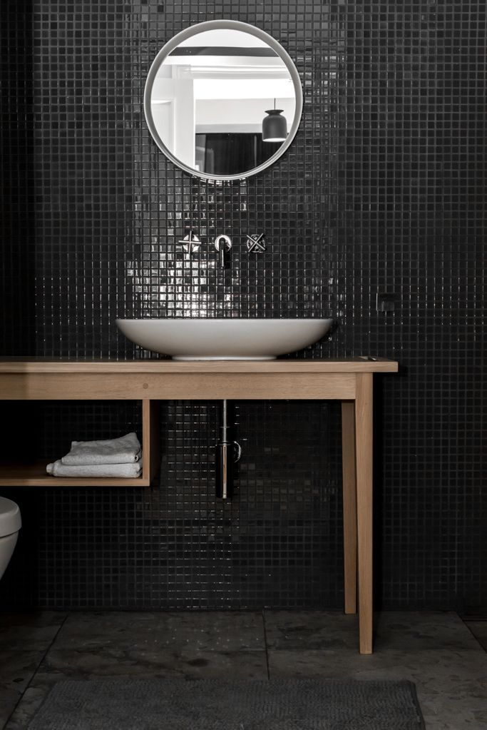 an edgy take on wall tile black tile