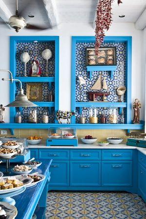 Bright, happy kitchen with tiled floor, backsplash, and shelves.  Ristorante Il Riccio | Anacapri, Italy