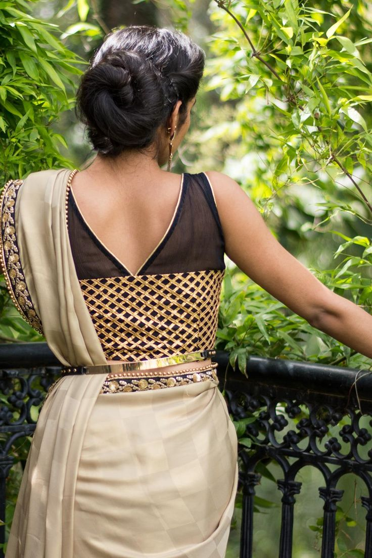 Simply glam this blouse! With criss cross checked pattern in gota on black net and a sheerblack chiffon yoke with gold edging, you can take this blouse anyplace and ooze sophistication.Pair it with gold, pair it with black or do a contrast saree with black edging and claim your space. Whatsapp +91 81050 68601. *Shipping worldwide* #saree #blouse #sareeblouse #blousedesigns #desi #indianfashion #india #bollywood #black #gold #chiffon #sheer #gota