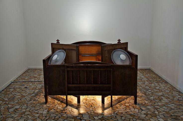 Nari Ward, Jacuzzi Bed, 2013, bedhead, fans, electric heater. Galleria Continua San Gimignano, 2013. Photo by: Ela Bialkowska.
