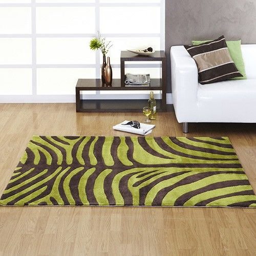 Dare To Be Different, And Impress With This Focal Point Green And Brown Rug  With