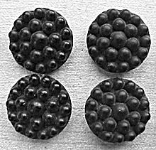 1860-1890 Jet or glass mourning buttons - shiny on the left for daily wear, matte on the right for mourning. Popularized by Queen Victoria, jet is 135 million year old fossilized wood aka coal. Glass was the affordable substitute.
