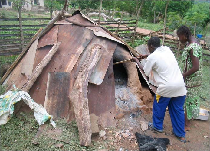 Earth oven in use. Sefwi-Wioso. Ghana.