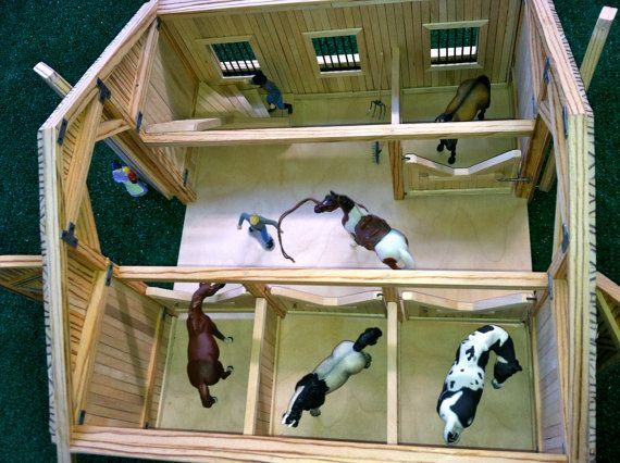 This is a beautiful custom hand made four stall barn created to scale for breyer stablemates (1:32). When you remove the real wood shake shingle
