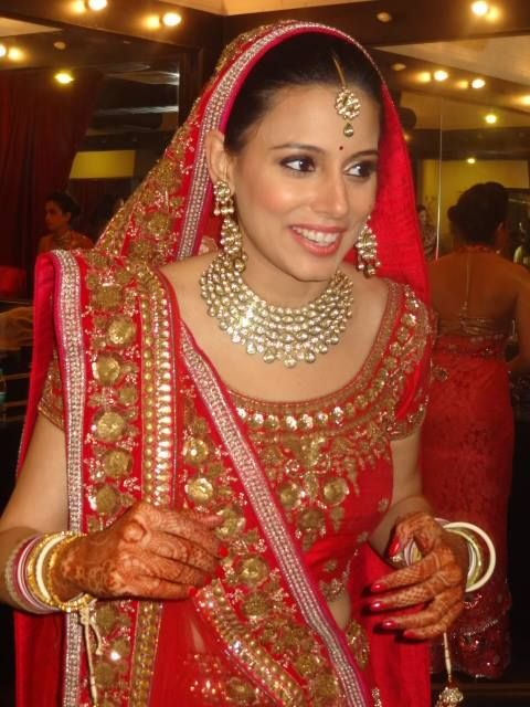 Indian bride wearing bridal lehenga and jewelry. #Beautiful #Weddingplz #Wedding #Bride #Groom #love # Fashion #IndianWedding #Beautiful #Style