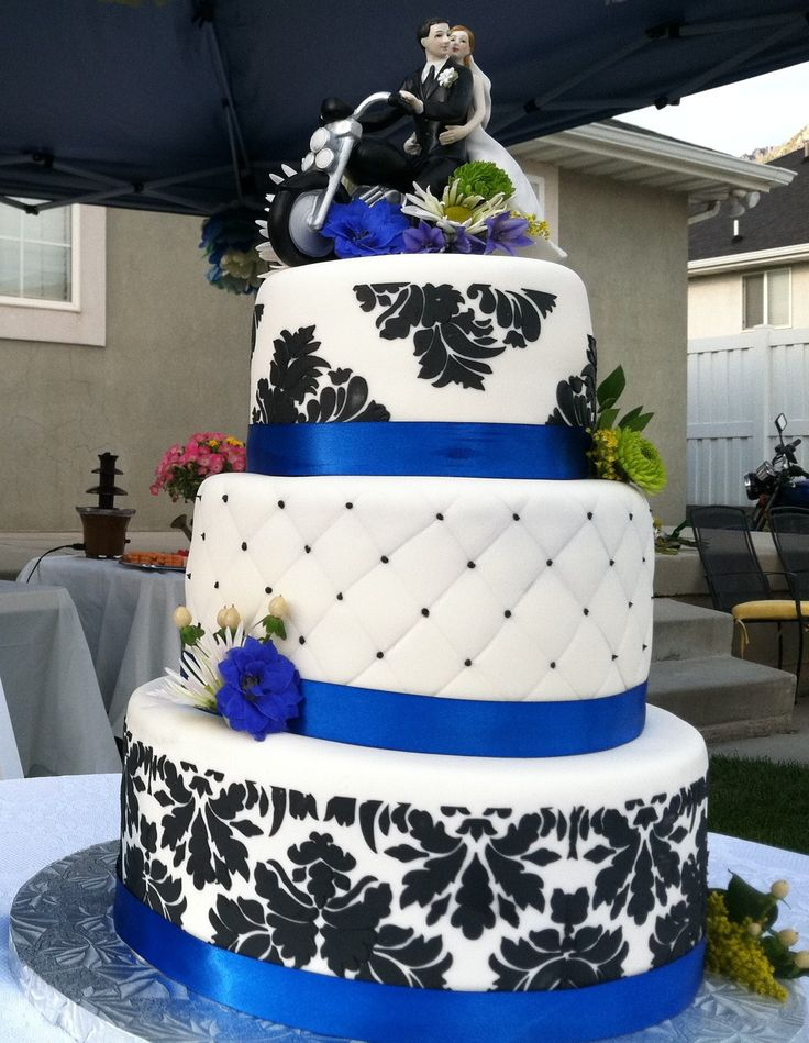 Blue Damask Wedding Cake - WASC cake with MMF.  Stenciled with royal icing, dots on quilted later with royal icing. Fresh flowers