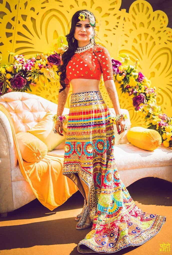 Quirky lehenga with crop top for mehendi function. See more