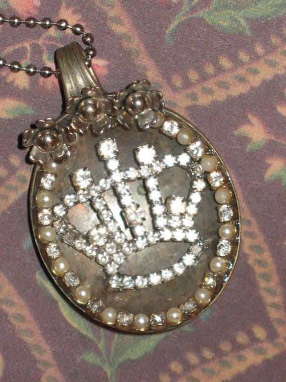 $14 An antique silver plated spoon has been made into a pendant necklace using a spoon and vintage rhinestones and a rhinestone crown.