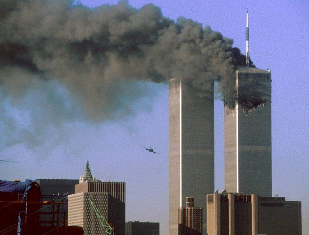 25 Most Powerful Photos: Hijacked United Airlines Flight 175 flies toward The World Trade Center Towers shortly before slamming into the South Tower(left) ..as the North Towers burns following an earlier attack by a hijacked airliner. The stunning aerial assaults on the huge commercial complex where more than 40,000 people worked on an ordinary day were part of a coordinated attack aimed at the Nation's Financial heart.