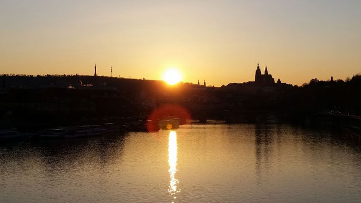 Sun going down over Petrin Park. Prague Castle is centre-right.