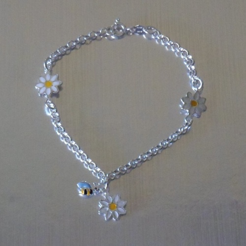 Pulseras de plata con flores