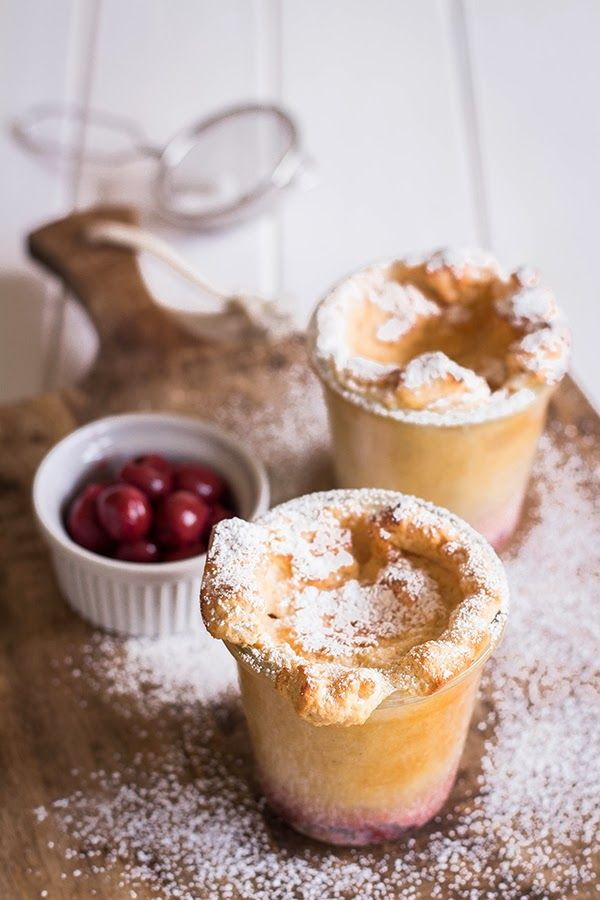 ... warm curd pudding with rum cherries ...