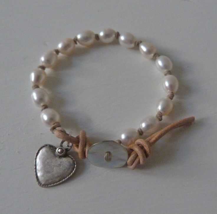 Nice heart charm addition to this leather and pearl bracelet...