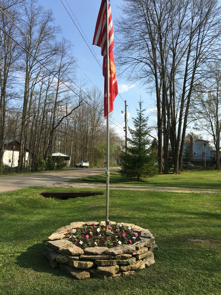 Rock ring flower bed around Flag Pole