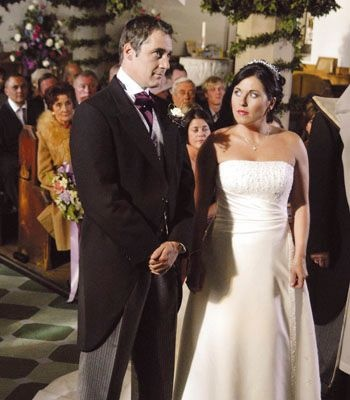 Before the wedding was stopped....Andy Hunter and Kat Slater, played by Michael Higgs and  Jessica Wallace.