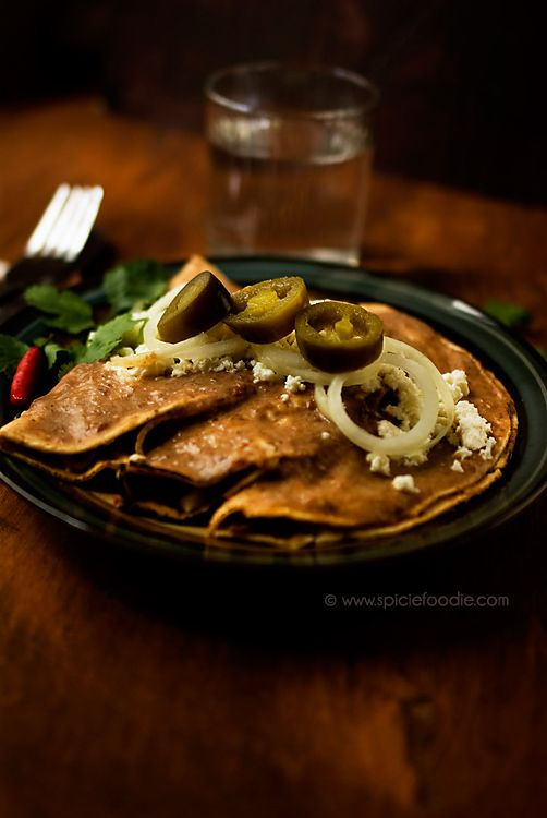 Chicken Stuffed Enfrijoladas Recipe by SpicieFoodie | Since so many people like celebrating Cinco de Mayo I thought it would be great to share a new authentic Mexican recipe, and some of my previously published ones, to celebrate the holiday. | From: spiciefoodie.com