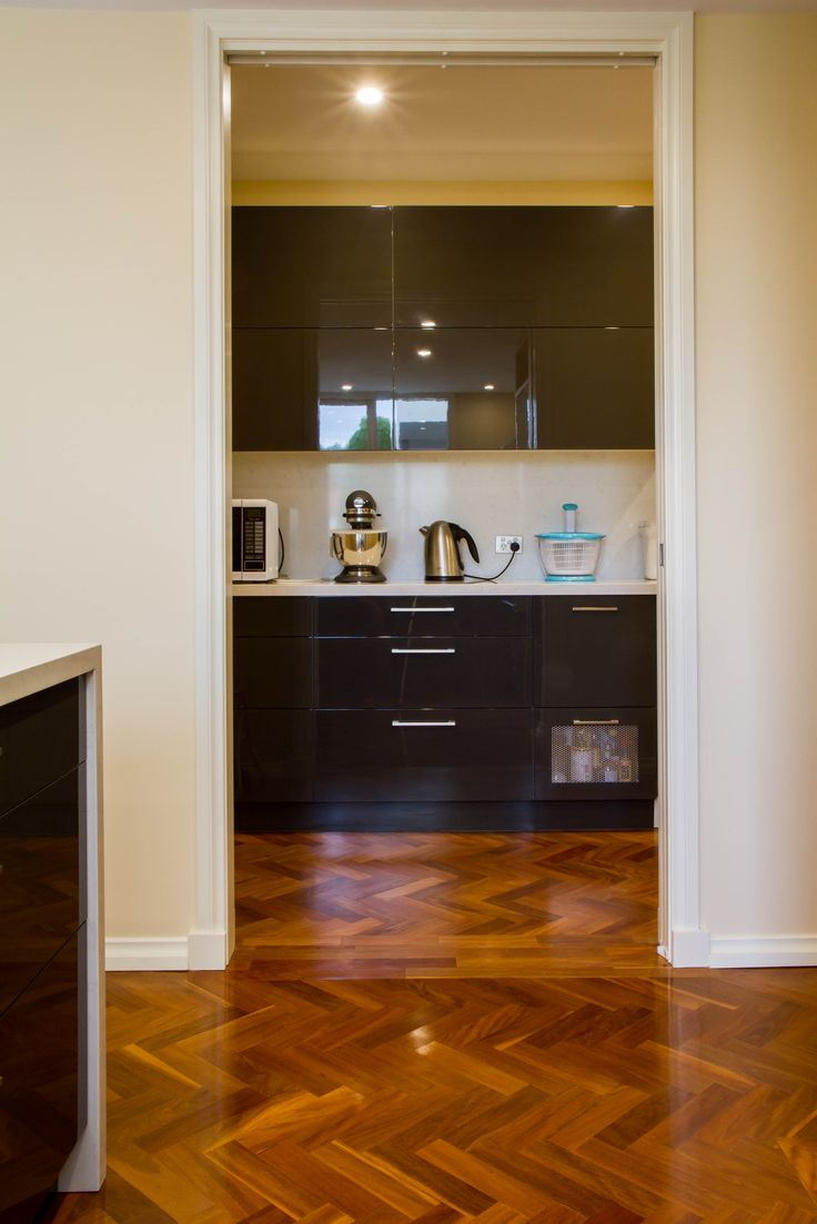 A compact, contemporary kitchen with high-end appliances, butler's pantry and home office desk. www.thekitchendesigncentre.com.au @thekitchen_designcentre