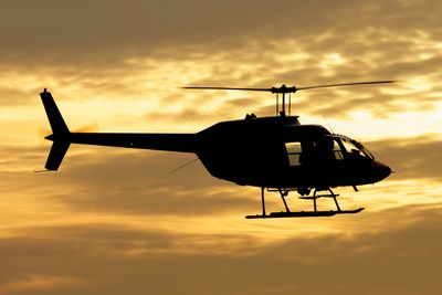 Silhouette of a Bell 206 Utility Helicopter