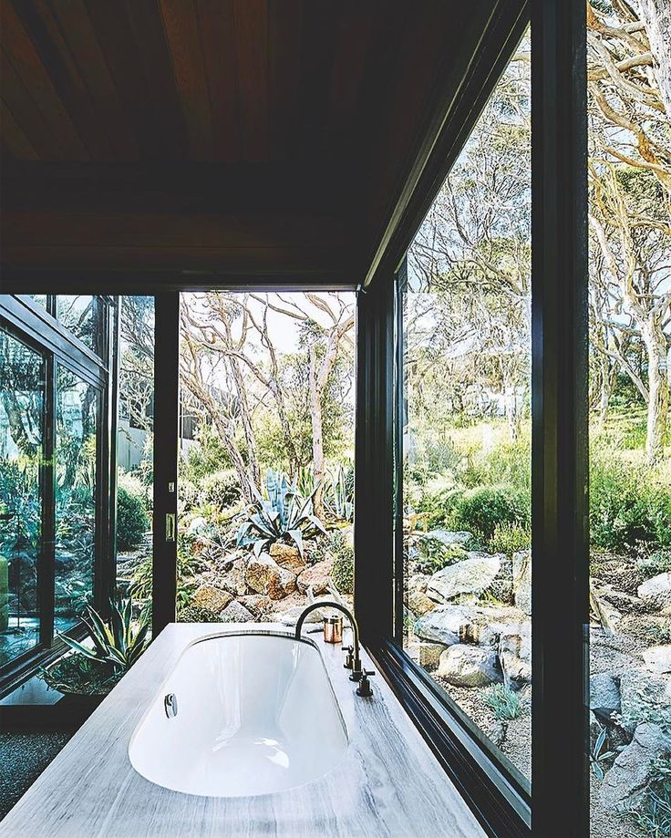 """What a setting! #trichovedic #hairwisdom #luxuryhaircare #trichovedicmood RepostBy @vogueliving: """"INTERIORS: Bath with a view! The main ensuite of SJB Interior designer Andrew Parr's Beach house on the Mornington Peninsula. Noceto Striato honed stone by Artedomus surrounds a bathtub from Reece; tapware from Astra Walker. For more of this blissful holiday home don't miss the JAN/FEB 2017 issue of Vogue Living on sale now! by @sharyncairns #VogueLiving #LoveVL #interiors #bathrooms #view…"""