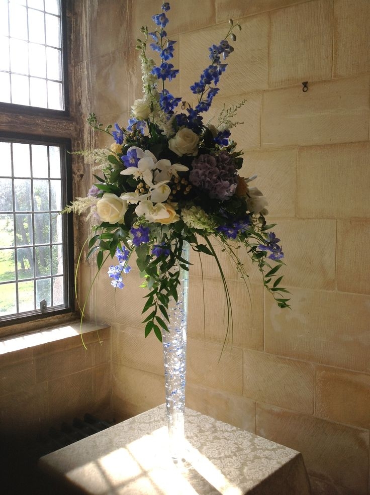 Large vase arrangement in blue, lemon and ivory
