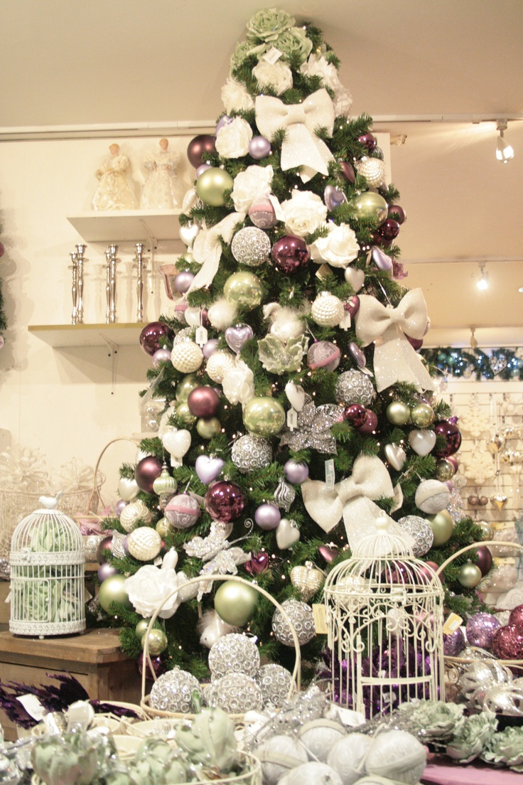 white, plum and soft green on a tree