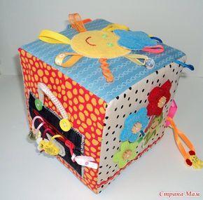 Развивающий кубик для малышки