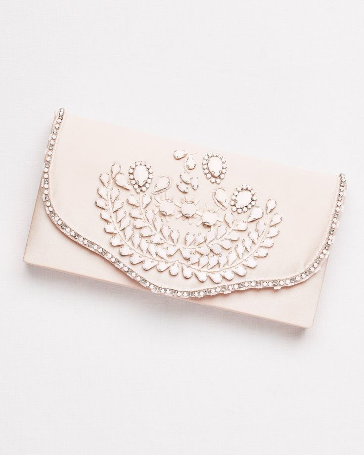 For stowing away your prom night essentials, this ivory  Hard-Sided Satin Clutch with White Beading coordinates perfectly! Shop this style at David's Bridal