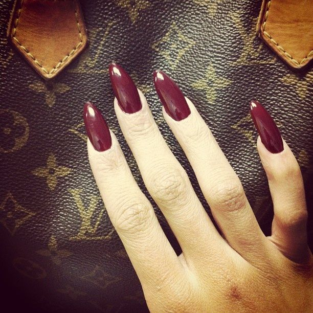 My nails looks exactly like this right meowww ha wine colored stiletto nails!