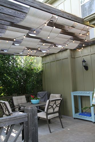 Use string lights and strips of canvas drop cloth to dress up a pergola. || @anythingpretty