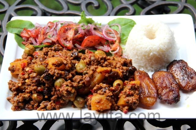 Picadillo is a typical Latin dish made with ground beef, potatoes, onions, garlic, cumin, bell peppers, white wine, tomato sauce, raisins, olives and capers.